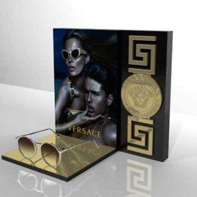 espositore plexiglass occhiali Versace oro specchiato